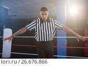 Купить «Male referee gesturing with arms outstretched», фото № 26676866, снято 22 января 2017 г. (c) Wavebreak Media / Фотобанк Лори