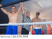 Купить «Referee holding hands of smiling male boxing winner by athlete», фото № 26676994, снято 22 января 2017 г. (c) Wavebreak Media / Фотобанк Лори