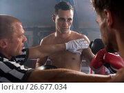 Купить «Referee stopping aggressive young male boxers», фото № 26677034, снято 22 января 2017 г. (c) Wavebreak Media / Фотобанк Лори