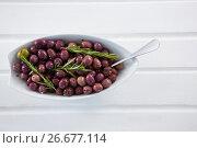 Купить «Olives garnished with rosemary», фото № 26677114, снято 15 февраля 2017 г. (c) Wavebreak Media / Фотобанк Лори