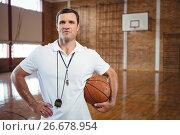 Купить «Portrait of confident basketball coach», фото № 26678954, снято 18 февраля 2017 г. (c) Wavebreak Media / Фотобанк Лори