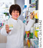 Купить «Portrait of female druggist working in pharmacy», фото № 26679642, снято 21 октября 2016 г. (c) Яков Филимонов / Фотобанк Лори