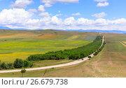 Купить «Panoramic view of the highland valley with the road», фото № 26679738, снято 14 декабря 2018 г. (c) Mikhail Starodubov / Фотобанк Лори