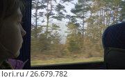 Купить «Enjoying travel - young girl traveling by bus and sitting near the window», видеоролик № 26679782, снято 17 мая 2017 г. (c) Dzmitry Astapkovich / Фотобанк Лори