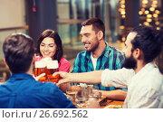 Купить «friends dining and drinking beer at restaurant», фото № 26692562, снято 8 ноября 2015 г. (c) Syda Productions / Фотобанк Лори