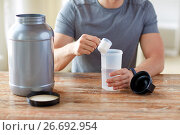 Купить «close up of man with protein shake bottle and jar», фото № 26692954, снято 14 мая 2015 г. (c) Syda Productions / Фотобанк Лори