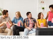 Купить «happy friends with popcorn and tv remote at home», фото № 26693566, снято 14 августа 2016 г. (c) Syda Productions / Фотобанк Лори