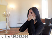 Купить «unhappy crying woman at funeral in church», фото № 26693686, снято 20 марта 2017 г. (c) Syda Productions / Фотобанк Лори