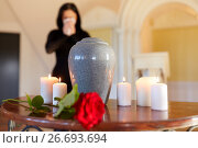 Купить «cremation urn and woman crying in church», фото № 26693694, снято 20 марта 2017 г. (c) Syda Productions / Фотобанк Лори