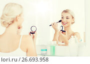 Купить «woman with makeup brush and blush at bathroom», фото № 26693958, снято 13 февраля 2016 г. (c) Syda Productions / Фотобанк Лори