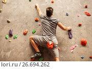Купить «young man exercising at indoor climbing gym», фото № 26694262, снято 2 марта 2017 г. (c) Syda Productions / Фотобанк Лори