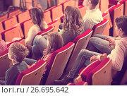 Купить «Cheerful group expecting movie to begin», фото № 26695642, снято 3 декабря 2016 г. (c) Яков Филимонов / Фотобанк Лори