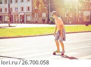 Купить «teenage boy on skateboard crossing city crosswalk», фото № 26700058, снято 19 июля 2016 г. (c) Syda Productions / Фотобанк Лори