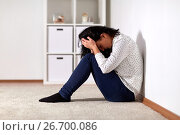 Купить «unhappy woman crying on floor at home», фото № 26700086, снято 20 января 2017 г. (c) Syda Productions / Фотобанк Лори