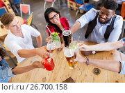 Купить «friends clinking glasses with drinks at restaurant», фото № 26700158, снято 2 мая 2017 г. (c) Syda Productions / Фотобанк Лори