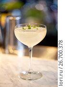 Купить «glass of cocktail at bar», фото № 26700378, снято 7 февраля 2017 г. (c) Syda Productions / Фотобанк Лори