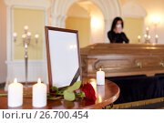 Купить «photo frame and woman crying at coffin at funeral», фото № 26700454, снято 20 марта 2017 г. (c) Syda Productions / Фотобанк Лори
