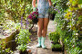 Low section of woman girl with flowering plants on footpath, фото № 26701778, снято 13 февраля 2017 г. (c) Wavebreak Media / Фотобанк Лори