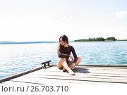 Купить «Стройная девушка в коротких шортах на пирсе», фото № 26703710, снято 23 июля 2017 г. (c) Момотюк Сергей / Фотобанк Лори
