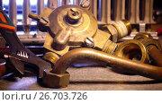 Купить «Details of water and gas fittings of the heater of water and metalwork tool adjustable wrench», видеоролик № 26703726, снято 24 июля 2009 г. (c) Куликов Константин / Фотобанк Лори