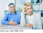 Купить «Mature couple decide family matters and find out relationship», фото № 26708110, снято 19 ноября 2018 г. (c) Яков Филимонов / Фотобанк Лори
