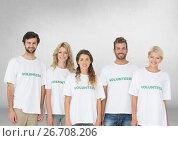 Купить «Group of volunteers standing in front of blank grey background», фото № 26708206, снято 19 августа 2018 г. (c) Wavebreak Media / Фотобанк Лори