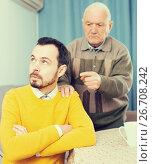 Купить «Father and son arguing», фото № 26708242, снято 22 сентября 2018 г. (c) Яков Филимонов / Фотобанк Лори