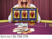 Купить «Casino slots spinning with worried man gambling his house in the background», фото № 26708378, снято 19 июля 2018 г. (c) Wavebreak Media / Фотобанк Лори