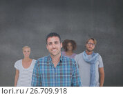 Group of people standing in front of blank grey background. Стоковое фото, агентство Wavebreak Media / Фотобанк Лори
