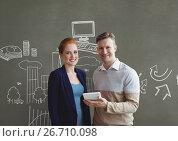 Купить «Happy business people holding a tablet against grey background with graphics», фото № 26710098, снято 23 мая 2019 г. (c) Wavebreak Media / Фотобанк Лори