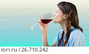 Купить «Woman tasting wine against light blue background», фото № 26710242, снято 26 июня 2019 г. (c) Wavebreak Media / Фотобанк Лори
