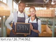 Купить «Composite image of portrait of smiling wait staff holding writing slate with text», фото № 26714062, снято 14 июля 2020 г. (c) Wavebreak Media / Фотобанк Лори