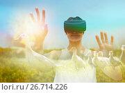 Купить «Composite image of woman using virtual reality simulator glasses», фото № 26714226, снято 26 мая 2019 г. (c) Wavebreak Media / Фотобанк Лори