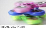 Купить «three spinning fidget spinners», видеоролик № 26714310, снято 18 августа 2019 г. (c) Syda Productions / Фотобанк Лори