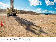 Купить «Drilling at an open pit», фото № 26715458, снято 13 июля 2017 г. (c) Mark Agnor / Фотобанк Лори