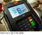 Купить «Современный терминал оплаты», фото № 26716206, снято 4 июня 2017 г. (c) Вячеслав Палес / Фотобанк Лори
