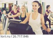 Купить «females training on elliptical trainers in fitness club», фото № 26717846, снято 23 февраля 2019 г. (c) Яков Филимонов / Фотобанк Лори