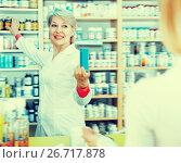Купить «Positive woman recommending care products», фото № 26717878, снято 15 марта 2017 г. (c) Яков Филимонов / Фотобанк Лори