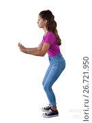 Купить «Girl pretending to be hold invisible object», фото № 26721950, снято 24 января 2017 г. (c) Wavebreak Media / Фотобанк Лори