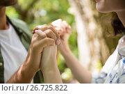 Купить «Mid-section of couple holding hands», фото № 26725822, снято 13 февраля 2017 г. (c) Wavebreak Media / Фотобанк Лори