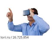 Купить «Smiling businessman pointing while wearing virtual reality simulator», фото № 26725854, снято 19 января 2017 г. (c) Wavebreak Media / Фотобанк Лори