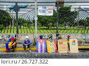 Купить «Warriors waiting. Opposition protesters assembled on the Francisco Fajardo motorway, near Francisco de Miranda Air Force Base in La Carlota, to demand...», фото № 26727322, снято 26 июня 2017 г. (c) age Fotostock / Фотобанк Лори