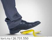 Купить «Man stepping on banana skin with black shoe», фото № 26731550, снято 4 апреля 2020 г. (c) Wavebreak Media / Фотобанк Лори