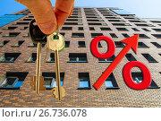 Купить «Красный знак процента на фоне жилого дома», фото № 26736078, снято 24 апреля 2016 г. (c) Сергеев Валерий / Фотобанк Лори