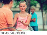 Купить «Girl is talking with boy», фото № 26736366, снято 8 июля 2017 г. (c) Яков Филимонов / Фотобанк Лори