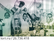 Купить «Boys and girls handing gifts to each other during dinner», фото № 26736418, снято 26 июня 2019 г. (c) Яков Филимонов / Фотобанк Лори