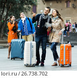 Купить «Two couples reading city map», фото № 26738702, снято 10 декабря 2018 г. (c) Яков Филимонов / Фотобанк Лори