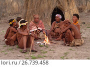 Купить «Group of bushmen or san in their village around a bonfire. Tsumkwe, Otjozondjupa, Kalahari, Namibia.», фото № 26739458, снято 18 августа 2014 г. (c) age Fotostock / Фотобанк Лори
