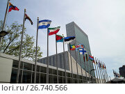 Купить «Flags flying outside the UN secretariat tower building united nations New York City USA.», фото № 26740566, снято 4 мая 2017 г. (c) age Fotostock / Фотобанк Лори
