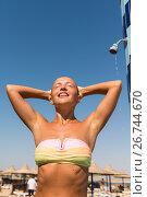Young woman taking shower. Стоковое фото, фотограф Никита Буйда / Фотобанк Лори